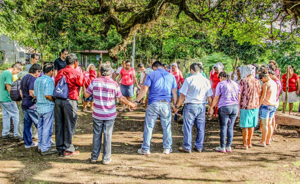 CAL PIC - Community leaders praying